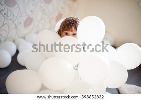 Girl with white ballons - stock photo