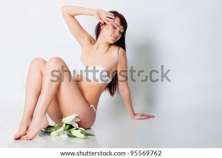 Girl with white lily in studio