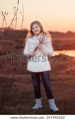 girl with willow on sunset - stock photo