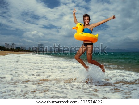 Girl with yellow duck lifebuoy - stock photo