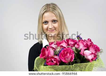 girl woman holding a bouquet of roses - stock photo