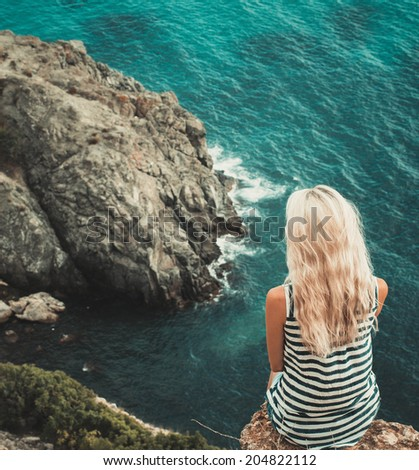 girl woman near the sea on the mountain - stock photo