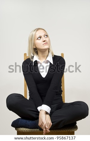 girl woman sitting on a chair - stock photo