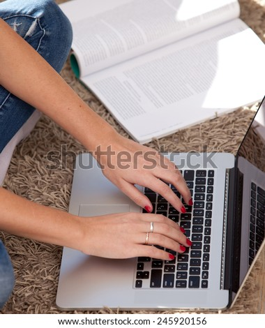 girl working distant and receives education on the computer - stock photo