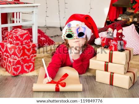 Girl writing a latter for santa - stock photo