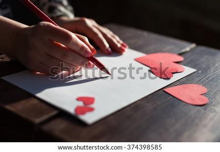 Girl writing love letter saint valentines stock photo royalty free girl writing a love letter for saint valentines day love concept spiritdancerdesigns Gallery