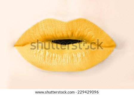 Girl yellow lips close up - stock photo