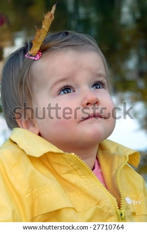 Girlbaby looks safely - stock photo