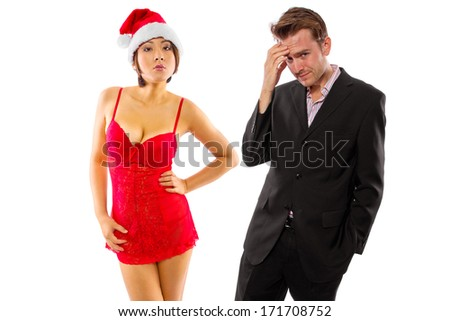 girlfriend seducing broke or stressed boyfriend on christmas - stock photo