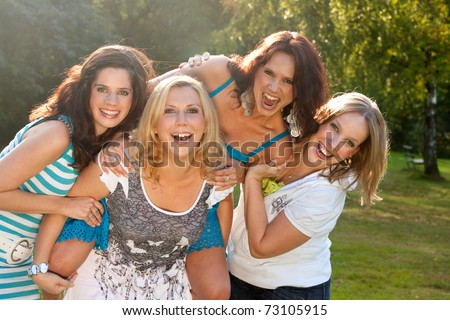 Girlfriends are having fun in the park - stock photo