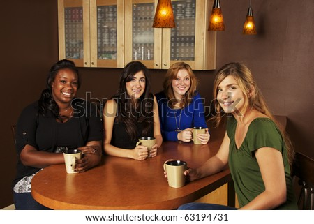 Girlfriends Coffee Talk - stock photo
