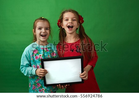 girlfriends girls hold empty blank for your text and advertising on a green background
