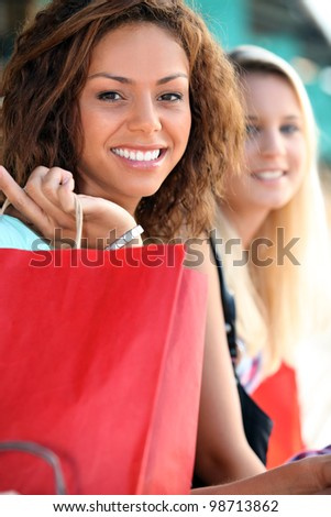 Girlfriends on a shopping trip - stock photo