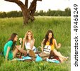 girlfriends on picnic - stock photo