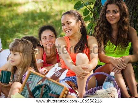 girlfriends on picnic in park