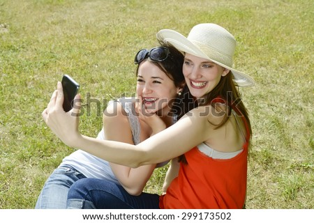 Girlfriends with smartphone, Selfie