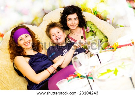 girls and boy are happy on  sofa - stock photo