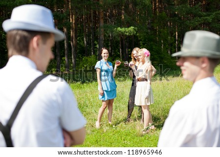 Girls and boys at the party outside - stock photo