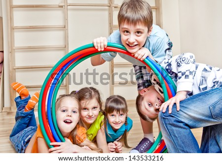 Girls and boys together in a gym - stock photo