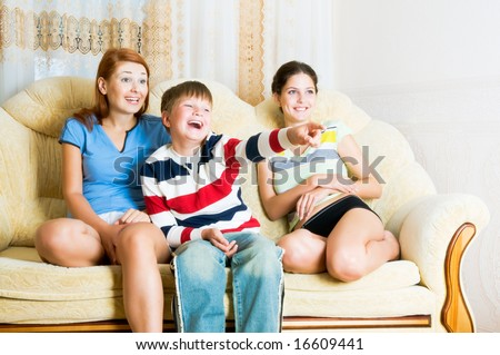 Girls and the boy  on  sofa - stock photo