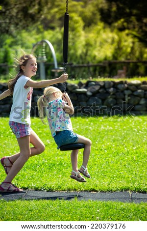 girls at the playground  - stock photo