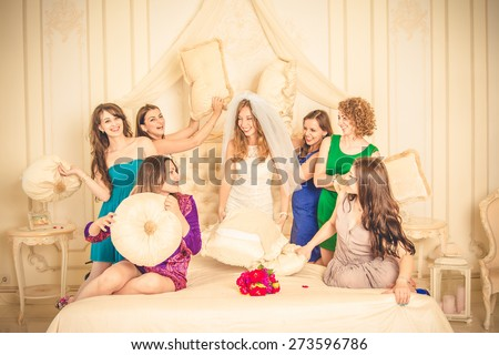 girls celebrate a bachelorette party of bride. bridesmaids fight - stock photo