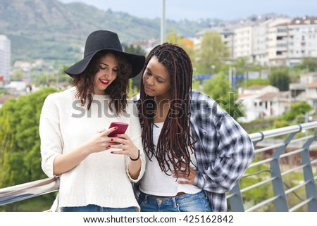girls chatting with mobile phone