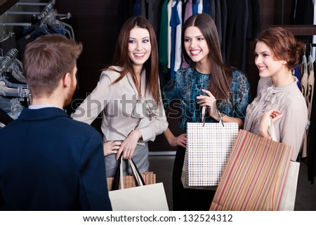 Girls consult with shop assistant of the store - stock photo