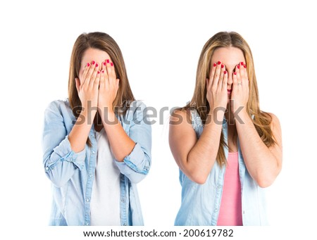 Girls covering her eyes over isolated white background  - stock photo