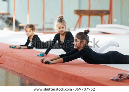 girls envy his classmate at the gym - stock photo