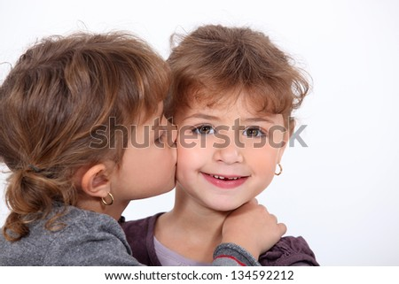 Girls giving a kiss - stock photo