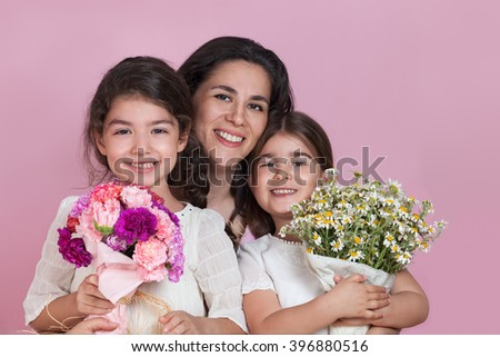 Girls giving flowers on Mothers day - stock photo