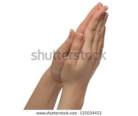 girls hands folded in prayer isolated on white - stock photo