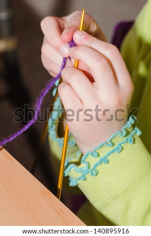 Girls hands knitting