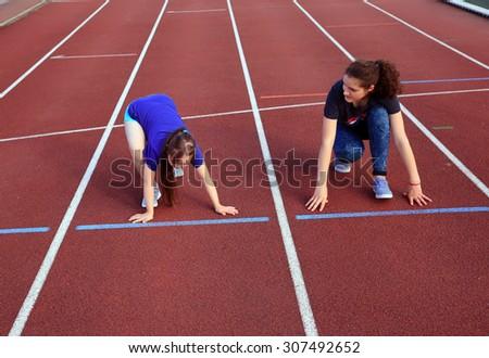 Girls have fun on the stadium - stock photo