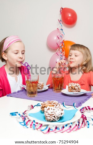 Girls having a traditional finnish May Day celebration, eating funnel cake, tippaleipa and drinking mead, sima