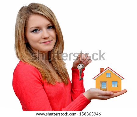 girls holding in hands house and key