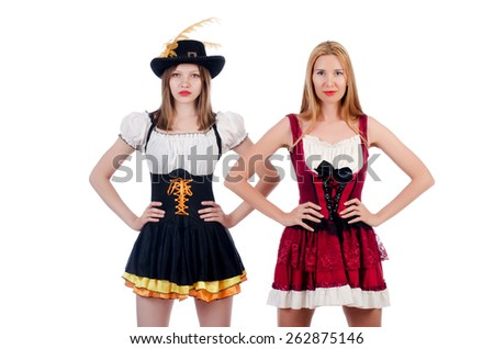 Girls in bavarian costumes isolated on white - stock photo