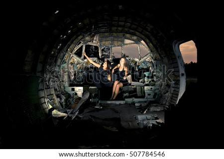 girls in ruined airplane