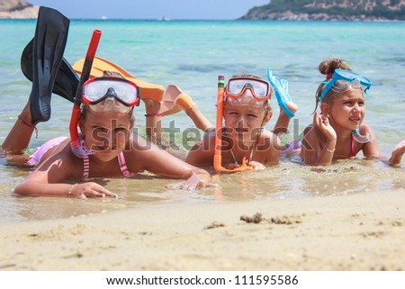 Girls in the sea - stock photo