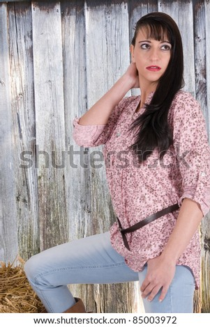 Girls in Western clothing from a wooden shed /Country Girl - stock photo