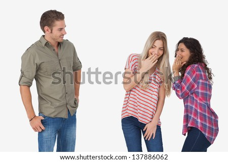 Girls laughing about secrets and leaving man out on white background