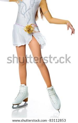 girls legs skating on the ice isolated on white background - stock photo