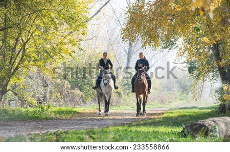 Girls on a horse ride. - stock photo