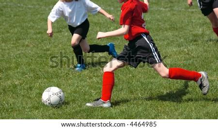 Girls on Soccer Field Fighting for Ball 3 - stock photo