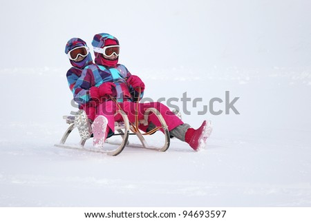 Girls on the sled - stock photo
