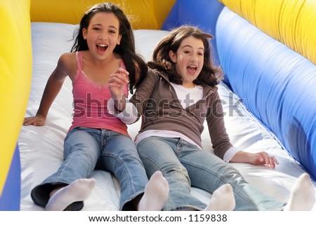 Girls on the slide - stock photo