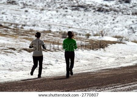 Girls Running Along Gravel Road in Wyoming - stock photo