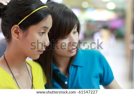 girls shopping at the mall - stock photo