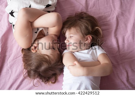 girls siblings sisters talk, children's secrets, hug, relationships sisters, close up, domestic real situation, the concept of childhood, lifestyle, - stock photo